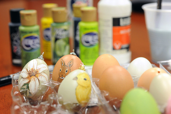 Examples of Easter eggs that have been painted by local artist Monica Anselmo that she had with her while giving a demonstration of her technique Wednesday, March 13, 2013.