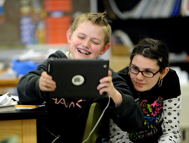 Conrad Ball Middle School students Daniel Haney, 12, and Faith Zorack, 11, work together to solve a math problem Tuesday afternoon in an after-school math and literacy tutoring program offered by their school in Loveland, Colo.