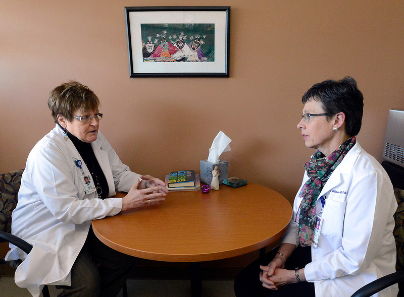 Pat Village, left, interim director of patient services, and Helen Kilzer, palliative care physician, talk about a patient at McKee Medical Center in Loveland on Monday, March 25, 2013.