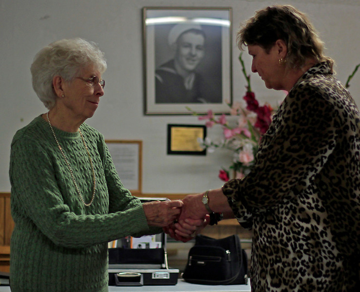 Joyce Abrams, left, receives her pin commemorating her five years of membership in the VFW Post 41 Ladies Auxiliary from club president Karen Magrum, Sunday evening, in downtown Loveland, Colo.  This year marks the 75th anniversary of the formation of the Ladies Auxiliary.