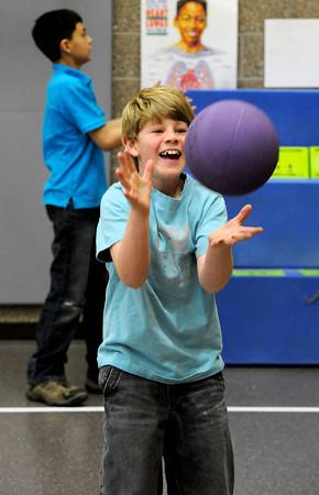 R.J. Hershfeldt, 10, plays ball during PE class at Ponderosa Elementery School on Wednesday, March 20, 2013.