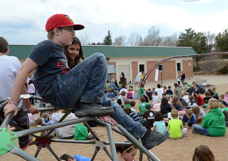 Big Thompson Elementary School fourth-graders Honus Wagner, 10, front, and and Sydney Hall, 10, perch atop a dome during a groundbreaking event March 29, 2013 for the school's new playground that's scheduled to open in August.