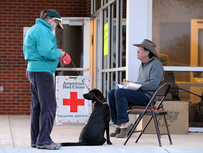 0316 NWS SoldFireEvac-js.jpg Penny Carson and her husband Gary Lyman wait at the Cache La Poudre Middle School in La Porte, the evacuation center, with their dog, Kona, after being evacuated from their home because of the Galena fire in Fort Collins on Friday, March 16, 2013.
