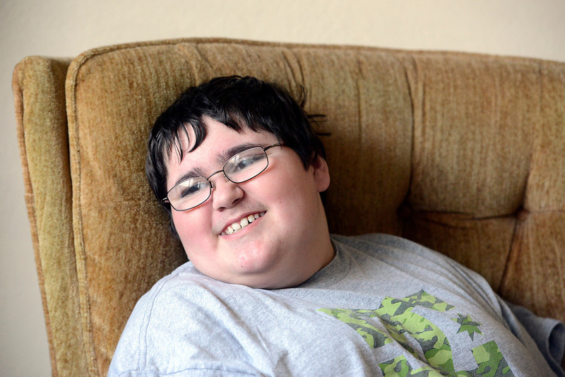 Relaxing in his Berthoud home on Wednesday, Alex Bray, 13, continues to smile despite the hardships he has faced since he was diagnosed with brain cancer at age 7. A fundraiser will be held for Alex at the Berthoud Community Center on March 24.