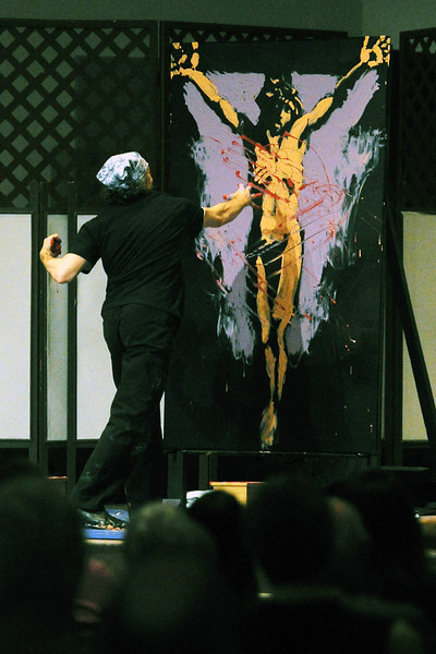 Loveland-based artist Scott Freeman works on a performance art piece during a Maundy Thursday Worship on Thursday, March 28, 2013 at Mountain View Presbyterian Church.