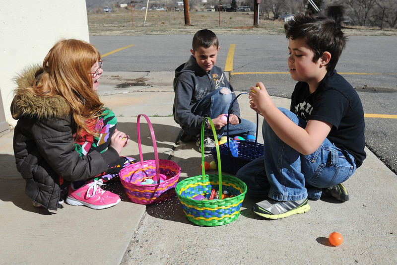 Hanna Schwartz, 8, left, Carter Stafford, 8, and Andrew Stafford, 10, empty out plastic eggs filled with treats after participating in an Easter egg hunt Saturday, March 30, 2013 at Buckhorn Presbyterian Church.