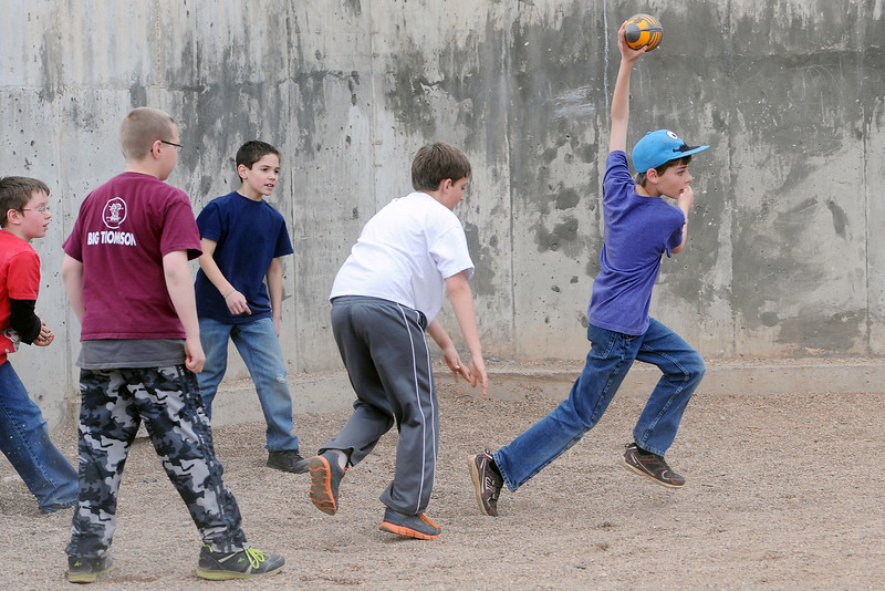 Big Thompson Elementary School fourth-grader Adam Cagnina, 10, right, runs after making a catch while playing football for the last time on the school's playground before its scheduled remodel with, from left, Brady Smith, 9, Austin Johnson, 11, Skyler Martinez, 10, and Ethan Basch, 10, after a groundbreaking ceremony for the new playground that's scheduled to open in August.
