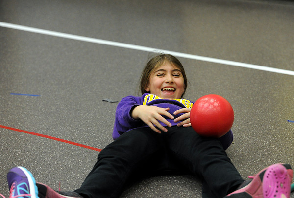 Kaytelyn Younghanz, 9, does sit ups with a smile during PE class at Ponderosa Elementary School, on Wednesday, March 20, 2013.