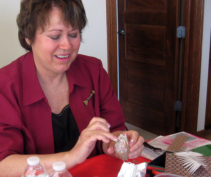 After a class on Washi eggs, which are decorated with Japanese paper usually used for origami, Loveland resident Dana Carlsen adapted the directions for a kid-friendly version. She glues the paper onto the egg at her Loveland home on Thursday, March 28, 2013.