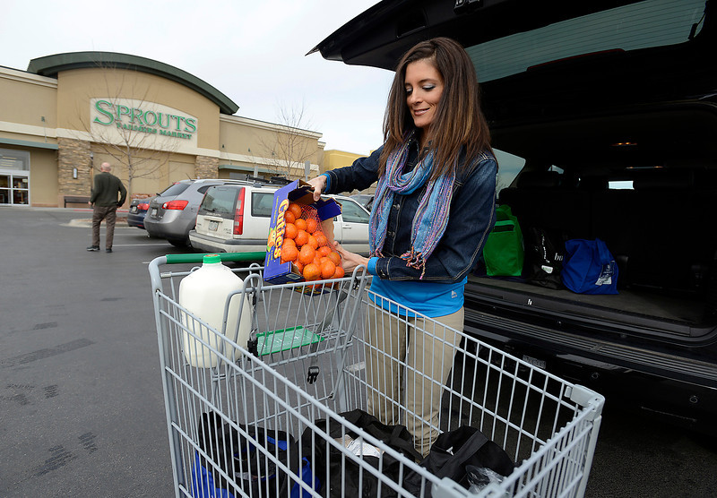 Juliette Fardulis of Loveland loads groceries into her vehicle after shopping at Sprouts Farmers Market in Fort Collins on Wednesday, Feb. 20, 2013. Fardulis frequently shops at natural grocers in Frot Collins and says she would be a regular if Loveland had a natural grocer.