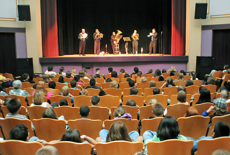 Members of the Apollo Chambers Brass perform onstage Tuesday at the Rialto Theater in downtown Loveland before an audience of students from Truscott Elementary School.