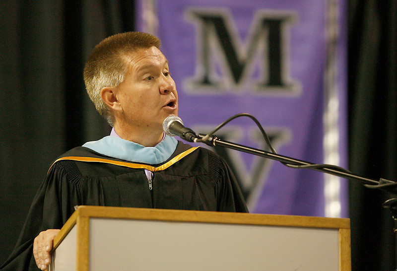 Mountain View High School Principal K. Kevin Aten, M. Ed. speaks to his graduating class Sunday at the Budweiser Events Center.