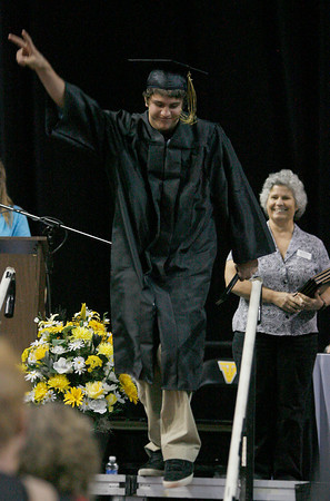 Max Lane walks off the stage after receiving his Thompson Valley High School diploma Sunday at the Budweiser Events Center.