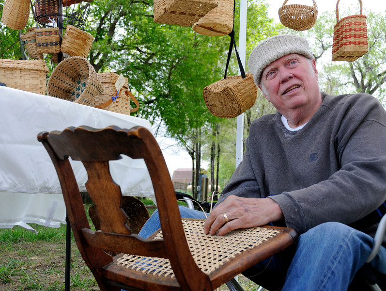 Frank Neckel puts the final touches on a heirloom chair at the Timberlane Farm Museum on Saturday, May 15, 2010.