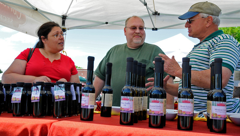 Loveland residents Lydia and Bob Brown, left, listen while Jim Shubin explains blackberry ginger balsamic vinegar dipping sauce Tuesday, May 25, 2010.