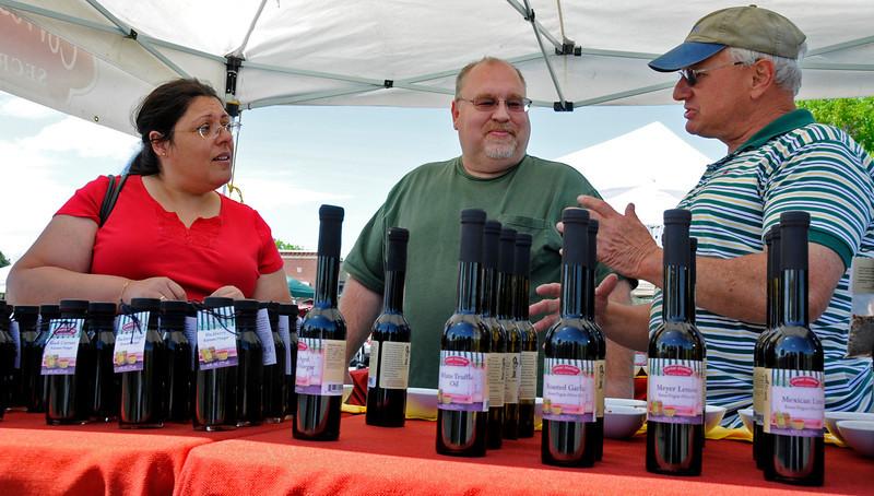 Loveland residents Lydia and Bob Brown, left, listen while Jim Shubin explains blackberry ginger balsamic vinegar dipping sauce Tuesday, May 25, 2010.