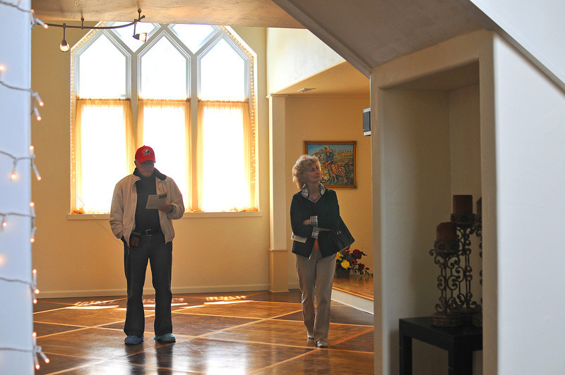 Bruce and Janet Harshberger explore the German Evangelical Church at 502 East Seventh Street, open to the public Saturday as part of the Historical Home Tour.
