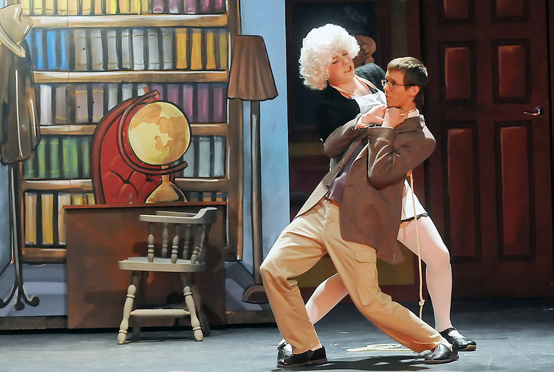 """Mountain View High School senior Greg Ahlquist, back, as """"Mrs. White,"""" and junior Conrad Shock as """"Professor Plum"""" act out a scene Wednesday during a dress rehearsal for the school's upcoming production of """"Clue: The Musical."""""""