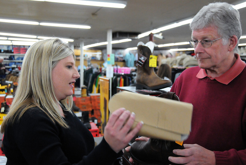 Jennie Balch (Left) assists Brian Hunt as he looks for a new pair of boots at Whiteside's Boat on Tuesday, May 11, 2010.