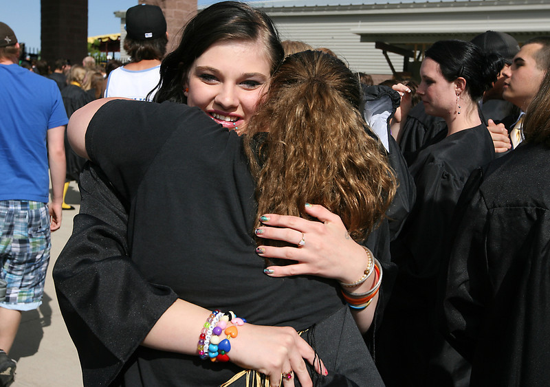 Kristal Wareing hugs Brenda Allen after the Thompson Valley commencement ceremony Sunday at the Budweiser Events Center.