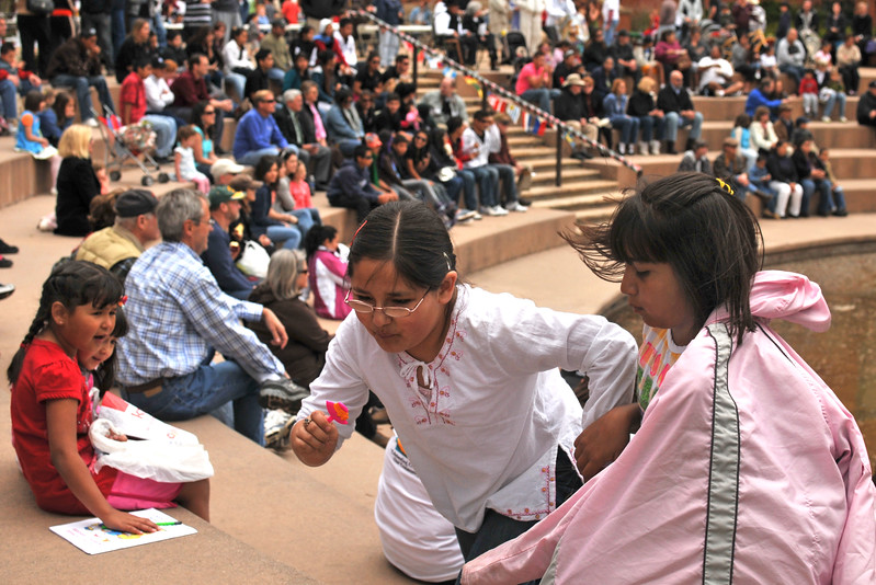 Brenda Garcia, 9, right, and Jazmin Quintana, 8, center, rush to the top of the Foote Lagoon amphitheater, Sunday, in between Cinco de Mayo performances down below, while Lesly Racio, 7, left, protests her friends' leaving.