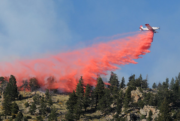 An air tanker based in Grand Junction drops retardant on an area of the Quillan Gulch fire two miles south of Drake on Sept. 30, 2008.
