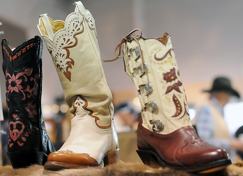 A wide variety of western-themed items like these cowboy boots are on display and for sale at the Loveland Old West Round-Up Western Collectible Show as well as saddles, spurs, firearms, jewelry, hats and western wear.