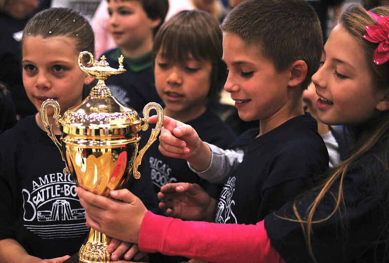 Third-graders of Monroe Elementary gather around their hard-earned trophy after winning Battle of the Books, Saturday.  The students had all year to read and study a whole list of books until thier knowledge was put to the test against other book worms their age.  From left to right, Cheyenne Tennyson, Clayton Knox, Jaxson Cabrera, Dominik Mieu, and Isabelle Simpson.  Other teammates not pictured are Trinity McNally, Quinn Fegel, Chase Quade, and Max Bridges.