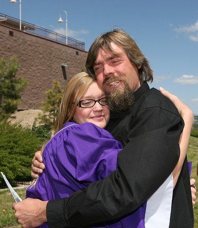 Tessa Whaley and her father Larry Whaley hug after the Mountain View High School commencement ceremony Sunday at the Budweiser Events Center.