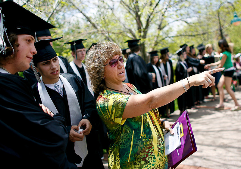 Kale Aman, left, and Lucas Ford listen as Guidance Counselor Jo Yaromy explains what to do when they reach the stage just prior to the start of their graduation ceremony on Thursday afternoon at Foote Lagoon, located on 3rd Street and Washington Avenue.