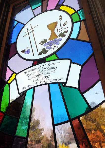 Stained glass inside the entryway at All Saints' Episcopal Church, 3448 N. Taft Ave. honors Rev. Sathi Bunyan's 25 years as rector at the church.
