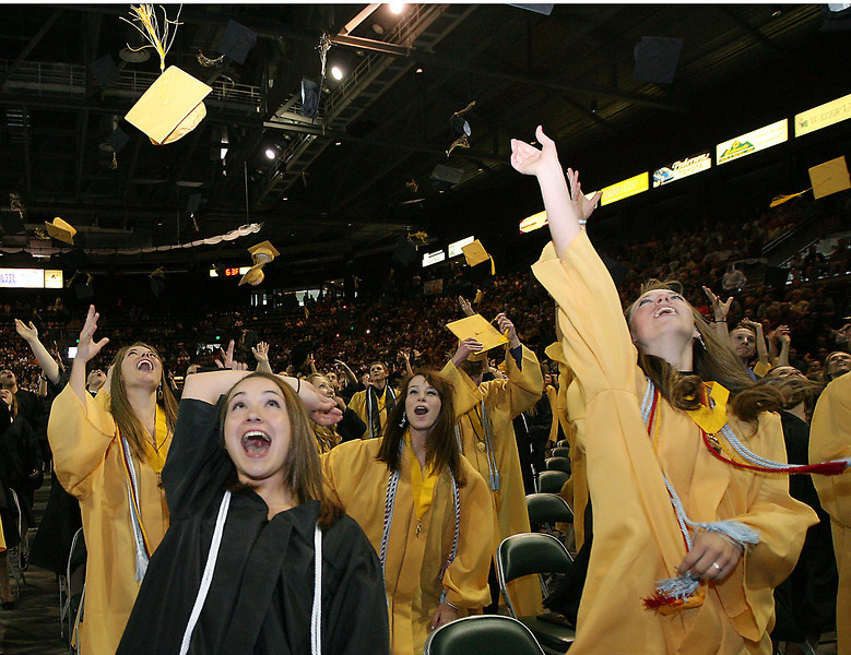 Lilianna Broussalian throws her cap in the air at the end of the Thompson Valley High School commencement ceremony Sunday at the Budweiser Events Center.