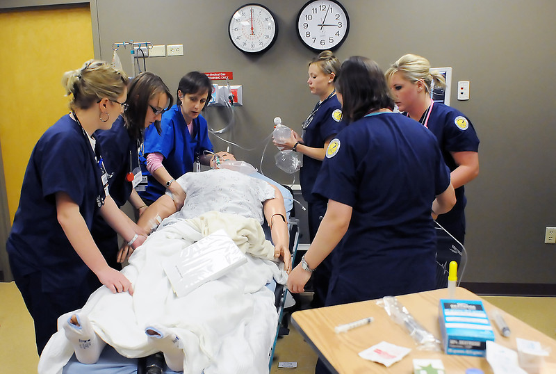 Clinical educator Megan Amaral, center, and nurses work together to treat an adult patient simulator displaying symptoms of a narcotics overdose during a training session Thursday afternoon at Banner Health's Western Region Simulation System at McKee Medical Center. The simulator has realistic anatomy and clinical functionality and allows for realistic training on a variety of patient care scenarios.