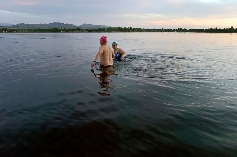 Loveland doctor Eliz Albritton-McDonald, background, and her training partner Joe Bakel of Fort Collins train for their July attempt at crossing the English Channel in Lake Loveland on Friday morning.