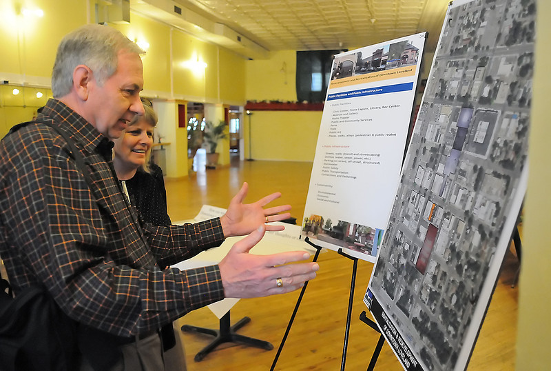 Norm Rehme, left, and Karen Clark look at an overhead map of downtown Loveland during an event Thursday evening at the Cherry Blossom Event Center, 315 E. 4th St. where city planners and consultants from TST Engineering met with members of the public to seek input on a major downtown redevelopment project.