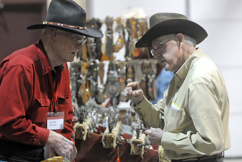 Charlie Shanks, left, and Jim Nicholls chat about spurs during the Loveland Old West Round-Up Western Collectible Show on Wednesday, May 19, 2010 in the Thomas M. McKee 4-H Youth and Community Building at The Ranch. The show continues today and Friday from 10 a.m. to 7 p.m. and Saturday  from 9 a.m. to 5 p.m. Admission is $7 for adults and children 12 and under are free with an adult.