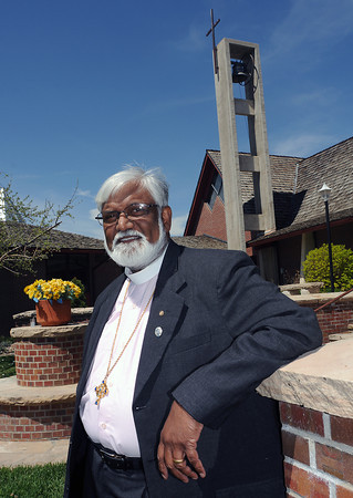 The Rev. Sathi Bunyan poses outside of All Saints' Episcopal Church, 3448 N. Taft Ave. on Tuesday.