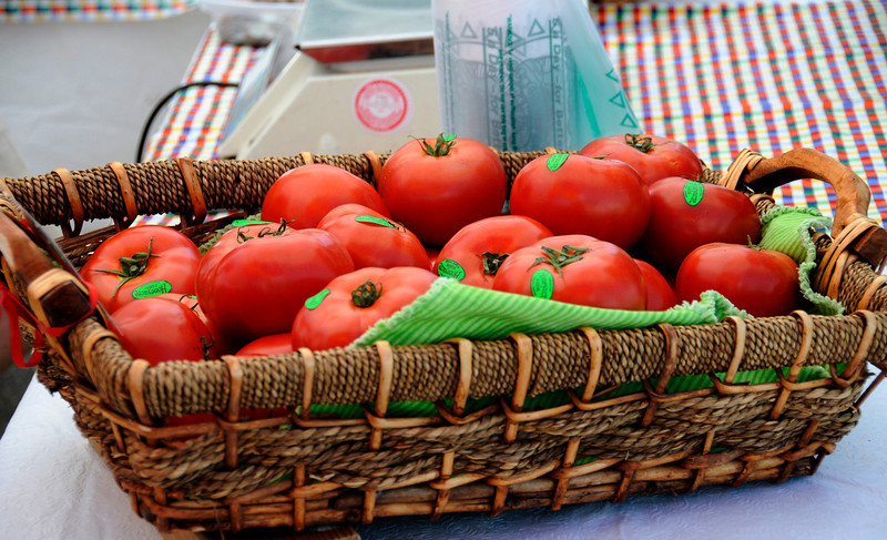 Tomatoes wait to be sold during the Farmer's Market Tuesday, May 25, 2010.