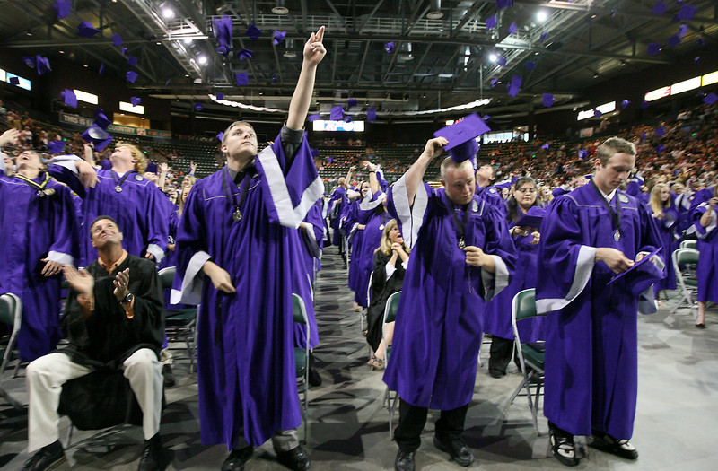 Evan Braunsroth throws his cap into the air after the Mountain View High School commencement ceremony Sunday at the Budweiser Events Center.