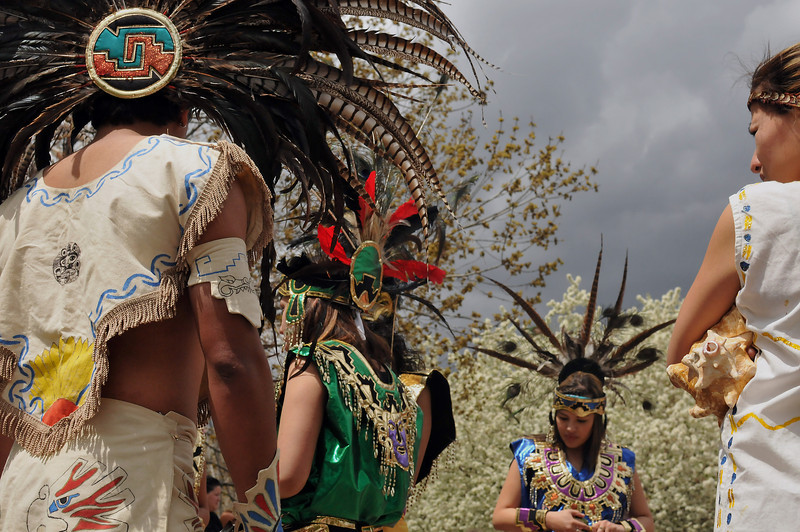Dancers of the Quetzalcoatl Aztec Dance wait to take the stage, Sunday, to perform in as part of the Cinco de Mayo celebration at Foote Logan.  From left to right, Hector Sandoval, Lizette Anaya, Briana Estrada, Yamel Alfaro.