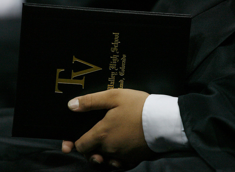 A Thompson Valley High School student holds his diploma during the commencement ceremony Sunday at the Budweiser Eventas Center.