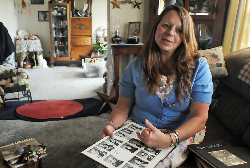 Berthoud, Colo. resident Pat Haworth holds a 1974 Berthoud High School yearbook opened to a page with her sister Corby Haworth's picture on it as she talks Wednesday, May 19, 2010 about her sister who died on July 4, 2008. (AP Photo/Loveland Reporter-Herald, Steve Stoner)