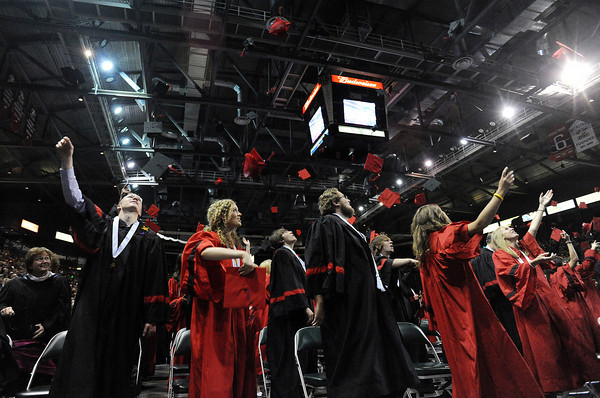 Loveland High School graduates celebrate after receiving their diplomas during the Loveland High School graduation at the Budweiser Events Center on Saturday, May 21.