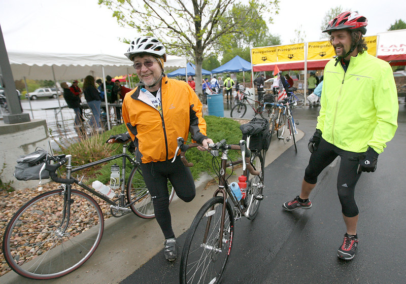 Dave Hilligoss, left, and Tyler Schwirtzstretch to get ready for the 24th annual Community Classic Bike Tour Sunday at the McKee Medical Center. (Photo by Gabriel Christus)