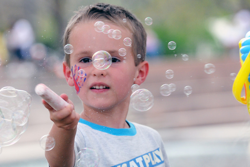 Loveland resident Samuel Woodward, 5, plays with a bubble machine Saturday, May 7, 2011 at Foote Lagoon during the Cinco de Mayo Celebration.
