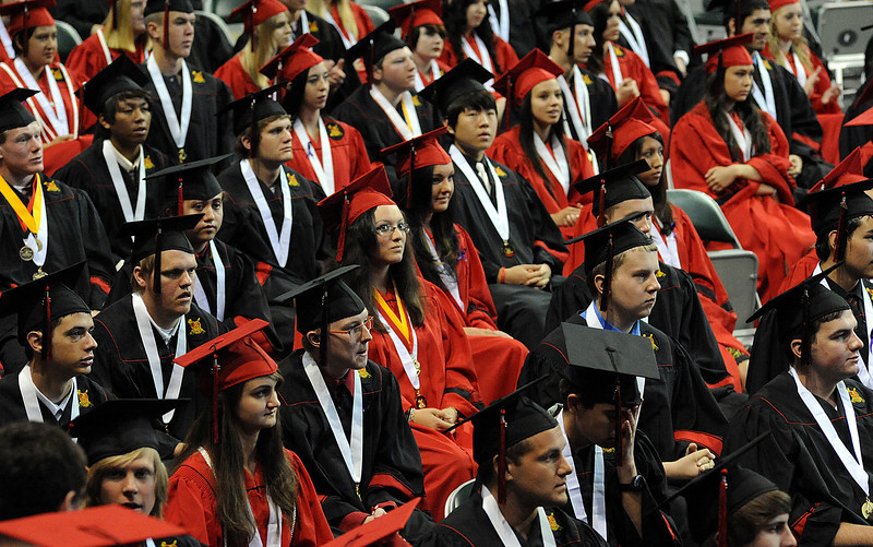 Graduates listen to speeches during the Loveland High School graduation at the Budweiser Events Center on Saturday, May 21.