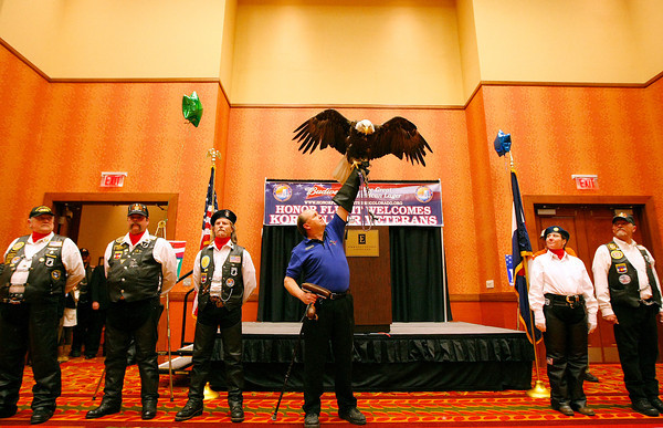 Robert Clearwater with Hawk Quest, holds up a Bald Eagle named Makowa with Patriot Guard Riders before Veterans leave for Washington DC on Sunday at the Embassy Suites in Loveland. (Photo by Gabriel Christus)