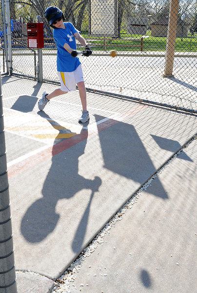 Twelve-year-old Tyler Luck smacks a hit while practicing his swing Wednesday afternoon at the City of Loveland's batting cages at Barnes Park. Tyler said he plays for the Loveland Bash baseball team and that he was trying out a new bat.