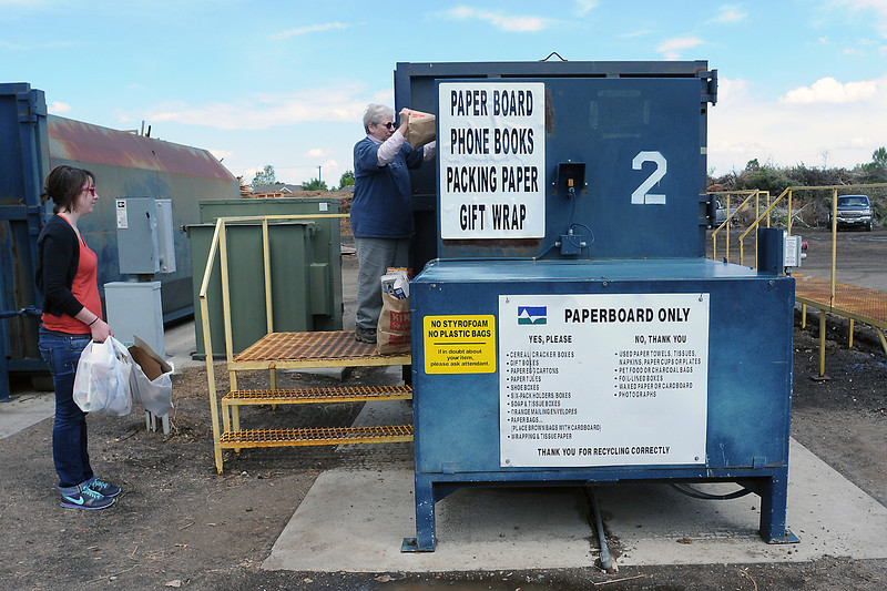 Rachel Morse, left, and Ginny Peabody recycle paperboard items Friday at the Loveland Recycling Center, 400 N. Wilson Ave.