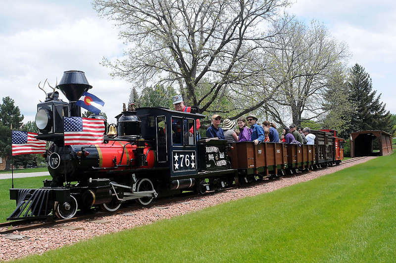 Buckhorn Northern Railroad engineer Harvey Ruegsegger, left, operates the train with the first passengers of the season on opening day Saturday at North Lake Park.
